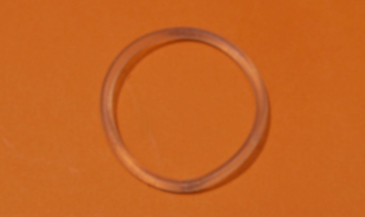 A photo of the nuvaring on an orange background.