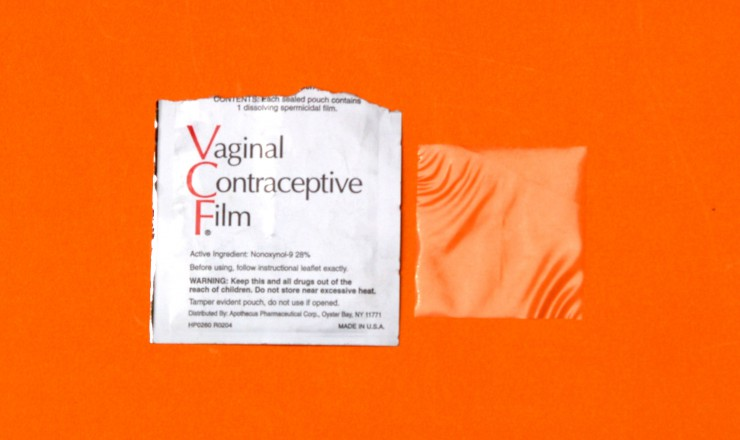 A photo of an opened package of Vaginal Contraceptive Film, featuring both the wrapper and the film. They are on an orange background.